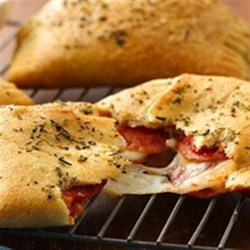 Big and Cheesy Pepperoni Pockets Recipe - Enjoy these cheesy pepperoni hand pies made using Pillsbury(R) Big & Flaky dinner rolls – a delicious dinner that's ready in 25 minutes.