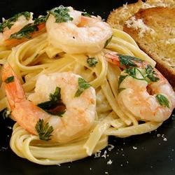 Shrimp Linguine Recipe - Shrimp, parsley, basil and thyme simmer in a dreamy garlic and cream sauce for a few brief moments before being tossed with hot pasta and Parmesan cheese. Season to taste and serve to a happy dinner party.