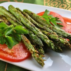 Grilled Parmesan Asparagus Recipe - Crispy Parmesan-coated asparagus prepared on the grill will make the whole family happy. Dip the grilled spears in butter for extra flavor.