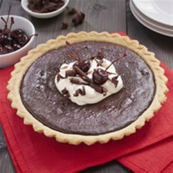 Black Forest Pie Recipe - Change up the classic Black Forest duo, cherries and chocolate, by layering the flavours in an easy pie. Decorate with whipped topping and chocolate curls for the full effect.