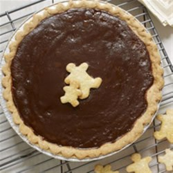 Gingerbread Pie Recipe - This custard pie has the warm, spicy flavour of gingerbread, rich with molasses, and is decorated with piecrust gingerbread men.