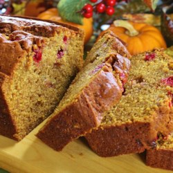 Holiday Pumpkin Bread Recipe - A fragrant array of spices -cinnamon, nutmeg, cloves and allspice -accent this moist pumpkin-nut bread peppered with juicy raisins.  The generous recipe makes three loaves, so plan on giving some away to friends and family.