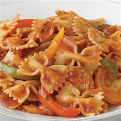 Contadina(R) Bow Ties In Sausage And Pepper Sauce Recipe - This one-skillet dinner with pasta, sausage, and colorful bell pepper strips is simmered in tomato sauce and ready to serve in half an hour.