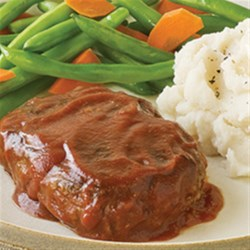 Contadina(R) Mini Meatloaves with Tomato Glaze Recipe - Mini meatloaves are browned in a skillet then simmered in a sweet tomato sauce glaze for a quick weeknight preparation.