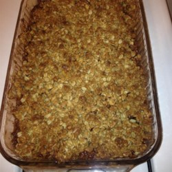 Healthier Apple Crisp II Recipe - This healthier apple crisp has all the traditional ingredients including apples, brown sugar, and cinnamon, but with less sugar, whole wheat instead of white flour, and the addition of walnuts.