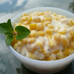 Slow Cooker Creamed Corn Recipe - Corn is combined with cream cheese, butter and milk, and simmered in the slow cooker.