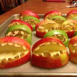 Halloween Fruit Apple Teeth Treats Recipe - These cute snaggle-toothed apple snacks contain nothing but fresh apples and slivered almonds, and kids love them.