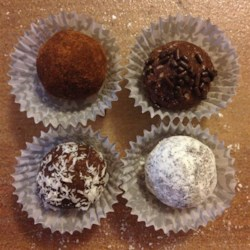 Cocoa Rum Balls Recipe - This delicious smooth confection is an impressive dessert for the holidays. These are wonderful for parties, and perfect for holiday gifts to your loved ones. A half cup of orange juice plus one teaspoon of freshly grated orange peel can be substituted for the rum in this recipe.