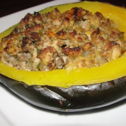 Squasage (Sausage-stuffed Squash) Recipe - Squash stuffed with a creamy sausage filling is the perfect addition to the Thanksgiving table or for a fancy weeknight dinner.