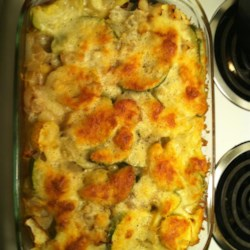 Roasted Zucchini Casserole Recipe - Zucchini slices are roasted with onions and baked over a layer of penne pasta and marinara sauce in this vegetarian casserole.