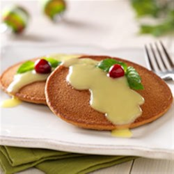 Gingerbread Pancakes with Warm Lemon Sauce Recipe - Gingerbread pancakes are served with a lemon sauce in this easy, fast recipe that's perfect for a special brunch.