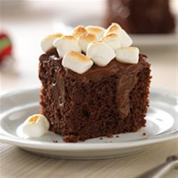 Toasted Marshmallow-Chocolate Pudding Cake Recipe - Chocolate pudding 'poke' cake is topped with creamy chocolate pudding and a layer of toasted marshmallows for a treat everyone will love.