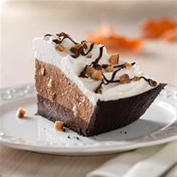 Fudge-Bottom Candy Crunch Pie Recipe - A chocolate-chocolate layer and a creamy chocolate layer on a chocolate cookie crust topped with chopped chocolate toffee make this pie a chocolate lover's dream.