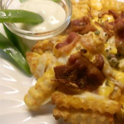 Yummy Cheese Fries Recipe - Easy and fast, these Cheddar cheese fries are served with bacon and dipped in ranch dressing.