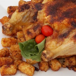 Roast Chicken with Curry Paste Recipe - With just 4 simple ingredients, this recipe will make a juicy, curry-scented whole roasted chicken for a nice variation on the usual.