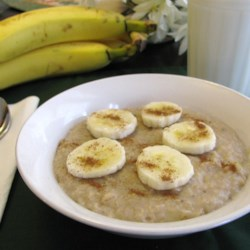Sweet Banana Almond Oatmeal Recipe - Almond milk and almond extract work with banana and to sweeten and flavor rolled oats in this quick and easy breakfast recipe.