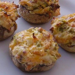 Hot and Spicy Stuffed Mushrooms Recipe - These hot and spicy stuffed mushrooms are loaded with jalapeno peppers, cream cheese, and bacon for a crowd-pleasing appetizer.