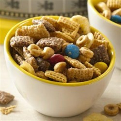 Minion Munch Chex Party Mix Recipe - Nuts about peanut butter and banana together?  This new dynamite party mix, with banana, peanut butter and just a touch of chocolate tossed in for good measure, is one tasty treat!
