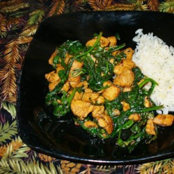 Myra's Basil Chicken Stir Fry Recipe - Stir fried chicken with fresh basil makes for a quick, simple and colorful dinner plate.