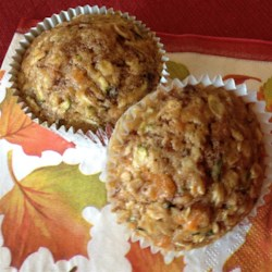 Sweet Potato Zucchini Muffins Recipe - Zucchini and sweet potatoes give these zucchini bread-inspired muffins an extra boost of color and fiber that the whole family will enjoy.