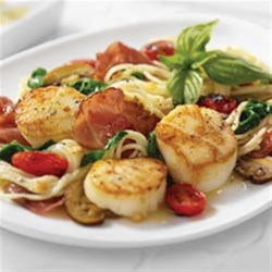 Angel Hair Pasta and Scallops with Margherita(R) Prosciutto Recipe - Crispy Margherita(R) Prosciutto slices and fresh seared scallops with sauteed garlic, mushrooms, tomatoes and spinach over angel hair pasta in a lemon butter white wine sauce.