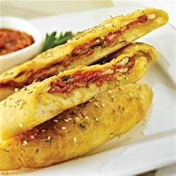 Mini Calzones with Margherita(R) Pepperoni Recipe - Mini calzones are stuffed with savory Margherita(R) pepperoni slices, shredded mozzarella cheese and fresh mushrooms.