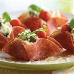 Salami Rosettes Recipe - Creamy cheese and tangy capers combine with the robust flavor of Margherita(R) Genoa salami and a hint of fresh basil for a sensational starter.