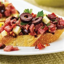 Margherita(R) Sun-Dried Tomato and Salami Bruschetta Recipe - Diced Margherita(R) Genoa salami, smoked Gouda cheese, chopped calamata olives and zesty seasoning make for a light yet satisfying appetizer.