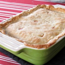Healthier Chicken Pot Pie IX Recipe - Made-from-scratch chicken pot pie just got healthier with more vegetables, low-fat milk, and less butter.