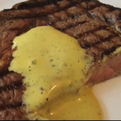 Chef John's Butterless Bearnaise Sauce Recipe - A version of the classic bearnaise sauce, made without butter, is thickened with egg yolks and flavored with tarragon Dijon mustard.
