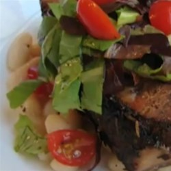 Chef John's Garlic-Studded Roast Pork Recipe - Pork shoulder roasted with plenty of garlic is sliced, pan-fried, and served over white beans with romaine and tomato salad for a gourmet take on a budget cut.