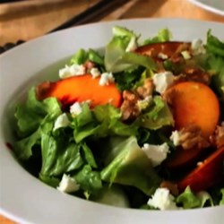 Peach and Escarole Salad Recipe - Delicious peaches, goat cheese, toasted walnuts, and a sweet vinaigrette are the perfect complement to escarole.