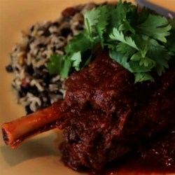 Lamb Shank Vindaloo Recipe - Lamb shanks are slow cooked with garam masala, ginger, paprika, cayenne, onions, and garlic for a tasty variation of a classic Indian vindaloo.