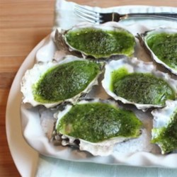 Chef John's Oysters Rockefeller Recipe - Oysters on the half shell are topped with a butter and herb puree and baked, creating one of America's iconic dishes served at Antoine's in New Orleans.