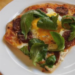 Chef John's Sausage and Egg Pizza Recipe - A pizza of cheese and sausage gets the delicious addition of lightly baked eggs for a treat that may change the way you eat eggs and pizza forever.