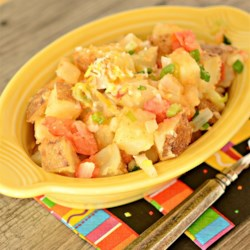 Mexi Tatoes Recipe - A great way to use left over mashed potatoes.  Or you can quickly cook and mash potatoes, and fry them with tomatoes, onions, chili sauce and garlic powder, and top with cheese.