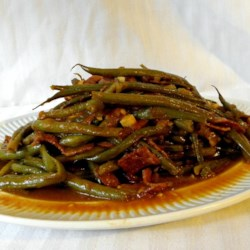 Slow-Cooked Green Beans Recipe - It's nice to cook fresh green beans to a buttery, tender texture over several hours with bacon, garlic, and onion for a different take on the often-chewy green bean. This recipe makes plenty of delicious juice that's just right for dipping corn bread.
