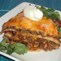 Spicy Beef and Bean Enchilada Pie Recipe - Chiles and pepperjack cheese give this hearty beef and black bean enchilada pie a spicy kick!