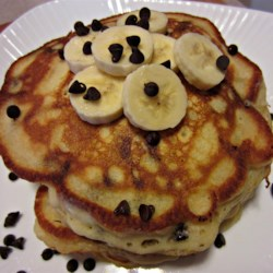 Banana Chocolate Chip Pancakes Recipe - Bananas and chocolate chips are folded into traditional pancake batter creating a sweet treat for weekend breakfast.