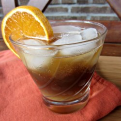 Black Rat Recipe - Thought to have been a drink among sailors, the black rat is orange juice, dark rum, and cola mixed together to ward off scurvy and perfect for Halloween parties.