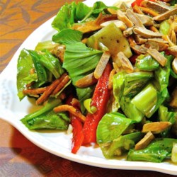 Crunchy Bok Choy Salad Recipe - This bok choy salad gets its crunch from ramen noodles and toasted almonds. It is then tossed with a balsamic vinaigrette and soy sauce dressing for a flavorful salad.