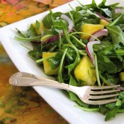 Pineapple Rocket Salad Recipe - Rocket is another name for arugula. The slightly peppery bite of arugula makes a great foil for sweet and tangy pineapple in a simple dressing.
