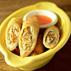 Lumpia Mollica Recipe - Crispy fried egg rolls filled with pork, onion, carrots, and celery make a delightful appetizer. Make and freeze a big batch so they're always on hand for those impromptu parties.