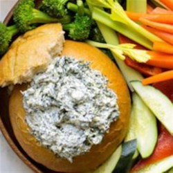 Original Ranch Spinach Dip Recipe - This crowd-pleasing appetizer features a hollowed-out loaf of French bread filled with a creamy mixture of sour cream, spinach, water chestnuts, and Hidden Valley(R) Original Ranch(R) Seasoning Mix.