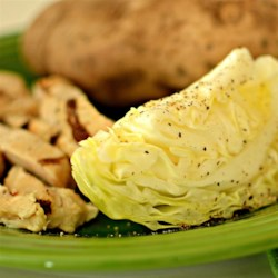 Grilled Cabbage I Recipe - Cabbage steamed in foil with butter and garlic. The perfect sidekick to grilled ribs or chicken!
