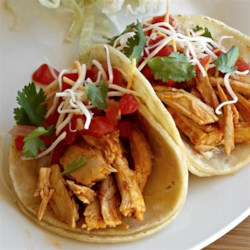 Steve's Roasted Chicken Soft Tacos Recipe - Seasoned rotisserie chicken, pico de gallo, and Mexican cheese blend layered in flour tortillas make quick and easy chicken soft tacos perfect for weeknights.