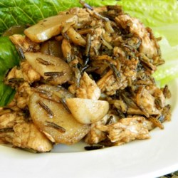 Best Wild Rice Salad Recipe - Nutty wild rice and tender chicken breast pair up with crunchy water chestnuts and a tangy walnut and balsamic vinaigrette in this fresh-tasting salad!