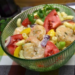 Momma's Pasta and Shrimp Salad Recipe - Small cooked shrimp, celery, tomato, and macaroni combine with Italian salad dressing and mayonnaise for a flavor-packed but light pasta salad.
