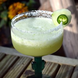 Jalapeno and Cucumber Margarita Recipe - The flavors of jalapeno pepper and cucumber infuse into a mixture of tequila, orange liqueur, and lime juice in this easy margarita recipe.