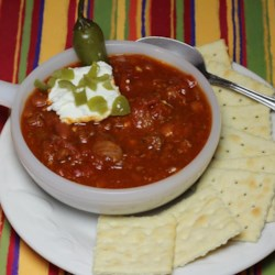 Cuddle Up Chili Recipe - Cuddle up with a warm bowl of spicy chili filled to the brim with beans, ground beef, and tomatoes on those cold weekend evenings.